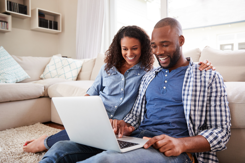 A couple buying a new home online