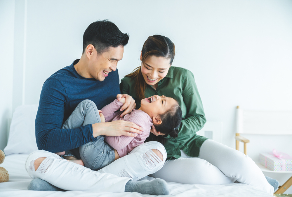 Family playing at home, Union Glen by Fieldgate homes coming soon