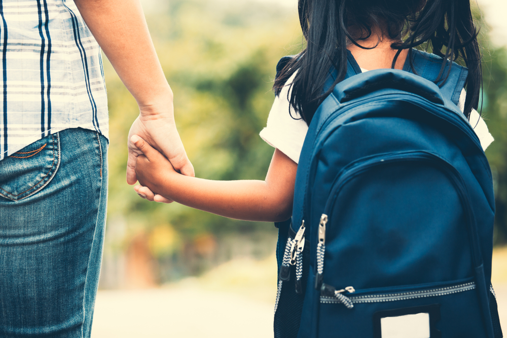 Student holding hand with parent in Shelburne