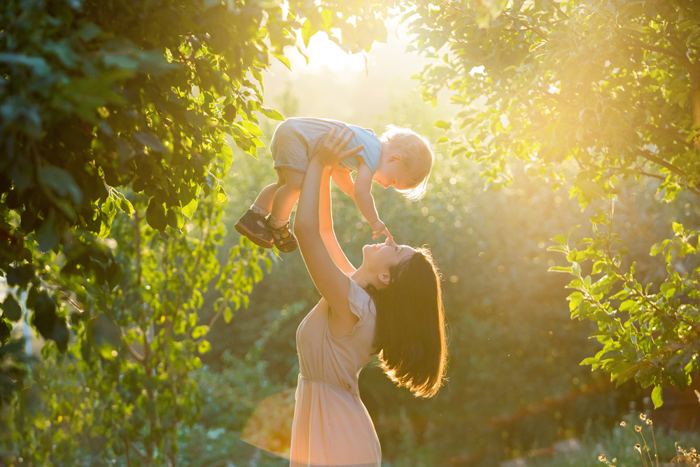 Mother in park holding child