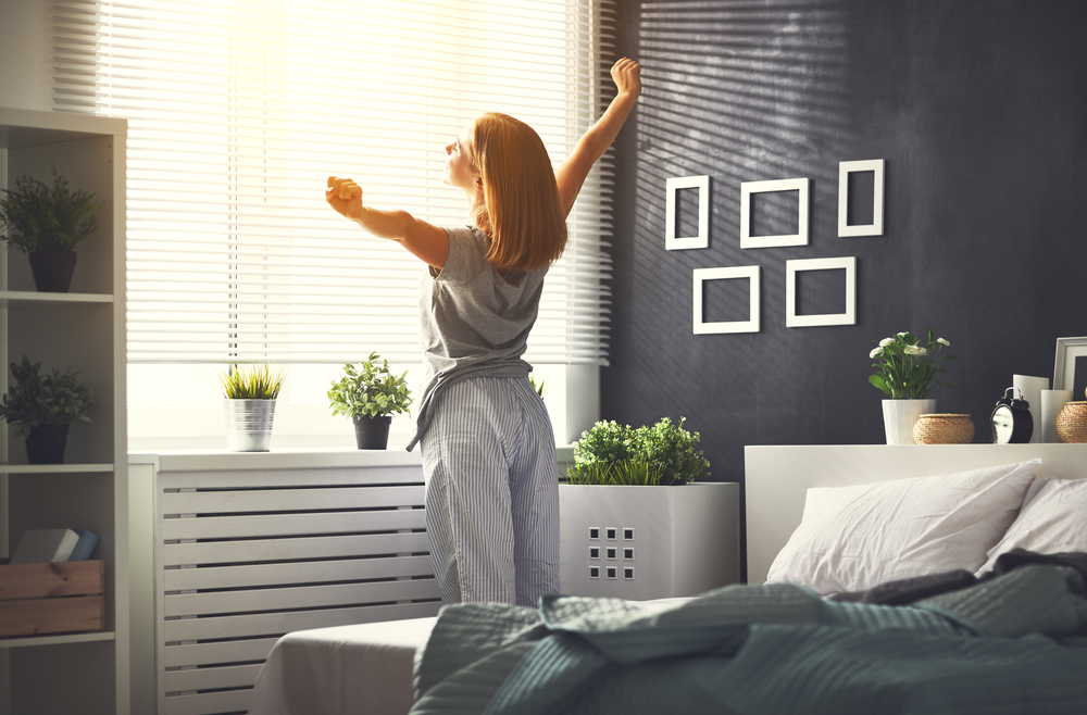 Woman waking up from a good dream, lifestyle photo for Dreamscape in Oshawa by FieldgateHomes
